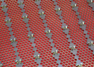 35325423 - metal surface with holes, industrial background